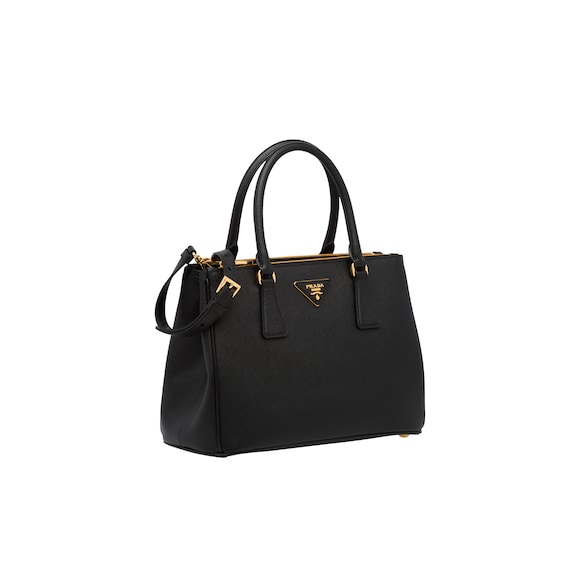 The Prada Galleria Bag Monochrome Saffiano Leather Is Accented With Metallic Tones Of Logo Zipper And Hardware