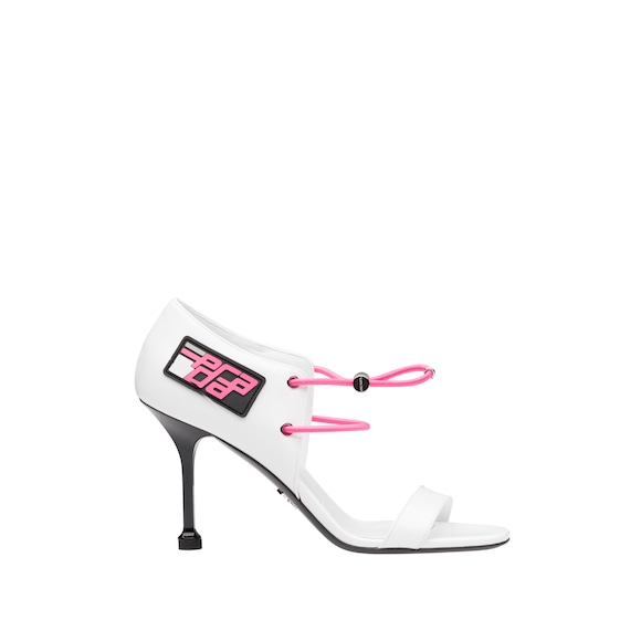 Patent leather sandals with elasticized cords