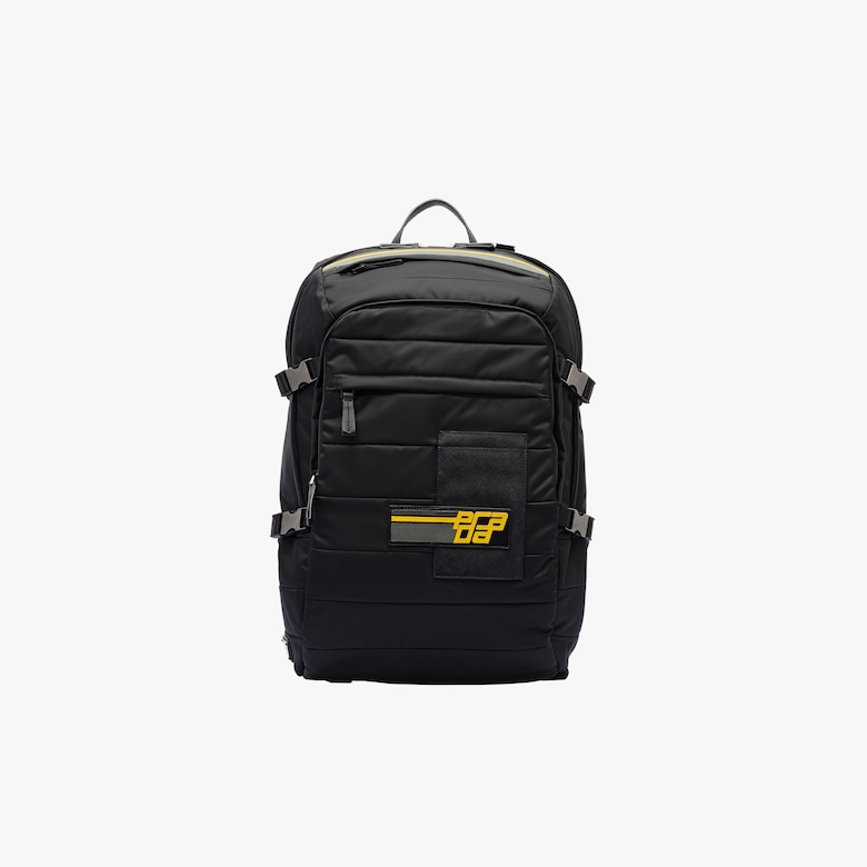 Stitched fabric backpack with patch