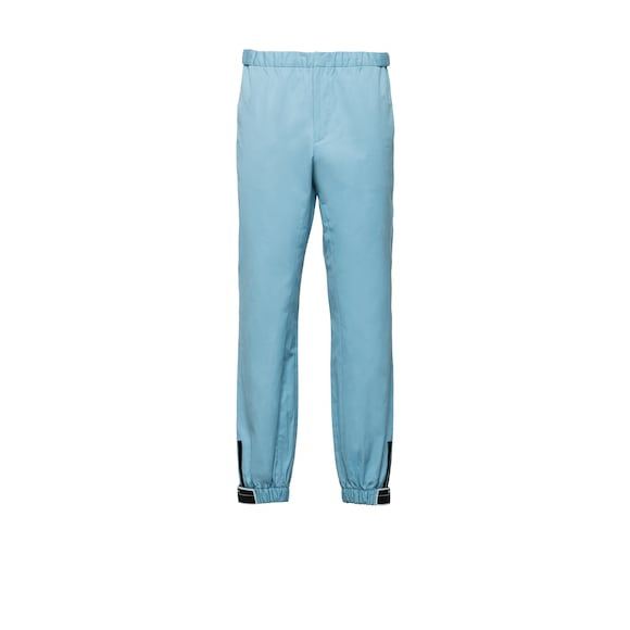 Cotton trousers with elasticized straps